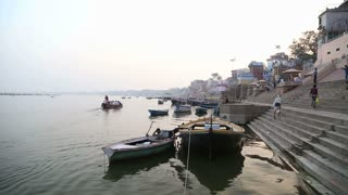 Boats anchored on the ghats of Ganges river in Varanasi.