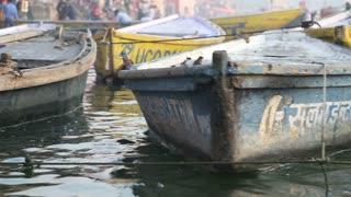 Boats at dock of Ganges river in Varanasi, closeup.