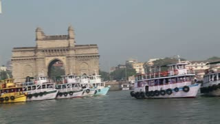 Boats floating on water in bay in Mumbai.