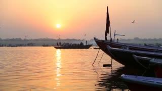 Boats on Ganges river in Varanasi at sunset.