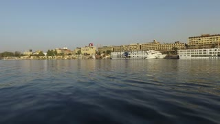 Boats on the Nile river at sunset near Aswan, Egypt