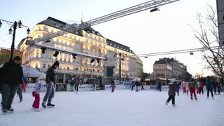 BRATISLAVA, SLOVAKIA - 6 JANUARY 2015: People skating at ice rink at sunny winter day in the centre of town.