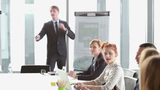 Business people talking during corporate presentation in conference room