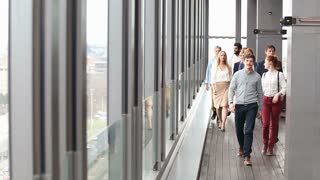 Business people walking towards camera