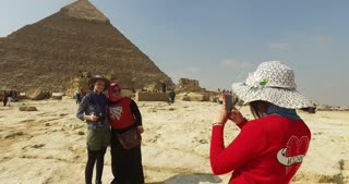 CAIRO, EGYPT - FEBRUARY 04, 2016: Tourists taking photos in front of Pyramid of Khafre in Giza