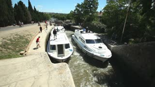 CANAL DU MIDI, FRANCE - JUNE 22: Boats at Fonserranes locks on June 22, 2013 on the Canal du Midi, France. 86 locks are situation on the 240km UNESCO listed canal from Toulouse to Bezier.