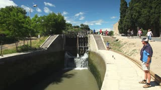 CANAL DU MIDI, FRANCE - JUNE 22: Tourists at Fonserranes locks on June 22, 2013 on the Canal du Midi, France. 86 locks are situation on the 240km UNESCO listed canal from Toulouse to Bezier.