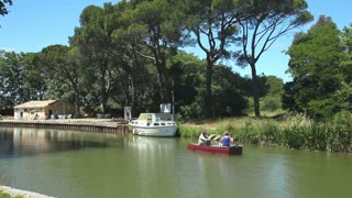 CANAL DU MIDI, FRANCE - JUNE 22: Tourists canoeing in summer on June 22, 2013 on the Canal du Midi, France. The UNESCO listed canal was built in 17th century stretching from Toulouse to Bezier.
