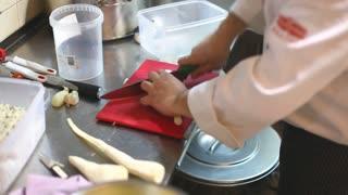 Chef chopping garlic