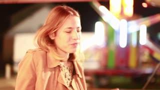 Close up of beautiful blonde woman dancing in amusement park