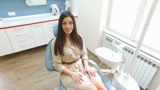 Close up of beautiful smiling woman with healthy white teeth at dentist