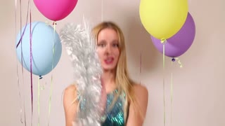 Close up of beautiful woman dancing with shiny brace string in photo booth