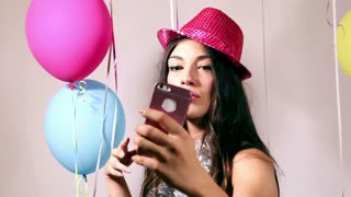 Close up of beautiful woman dancing with smartphone and taking selfies
