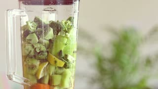 Close-up of blending food in electric blender, in slow motion, graded