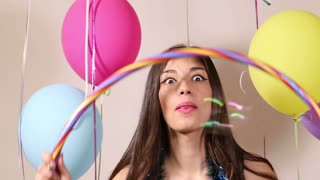 Close up of brunette woman playing with hula hoop in party photo booth