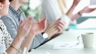 Close up of business people clapping hands in conference room, slow motion