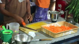 Close up of chef cutting carrots in a restaurant kitchen in Weligama.
