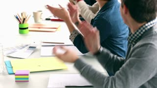 Close up of colleagues applauding their boss after presentation, slow motion, graded
