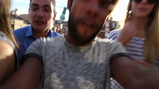 Close up of crazy group of friends filming themselves at rooftop party