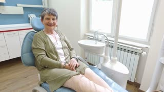 Close up of elderly woman sitting in the dental chair