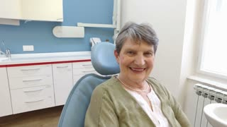 Close up of happy elderly female patient at dentist