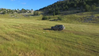 Close up of jeep off road on Dinara mountain