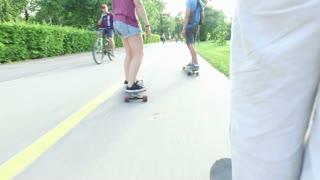 Close up of people legs on a skateboard