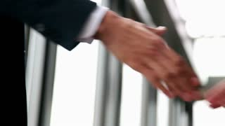 Close up of two businessman shaking hands in office