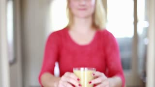 Close-up of Woman's hands holding glass of fruit smoothie