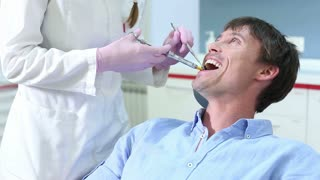 Close up of young male patient receiving injection at dentist