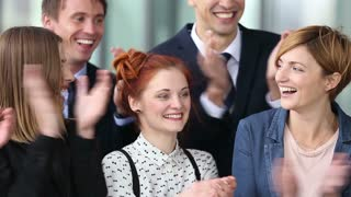 Close up portrait of happy business people clapping