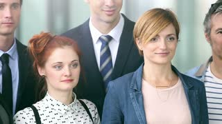 Close up portrait of young business people smiling, graded