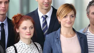 Close up portrait of young business people smiling