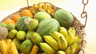 Close up view of fruit basket swinging in the wind in Weligama, Sri Lanka. Tropical fruit is available all year round.