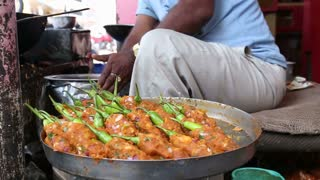 Close view of food preparation��on street stall in India.