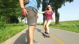 Close view of man longboarding with friends