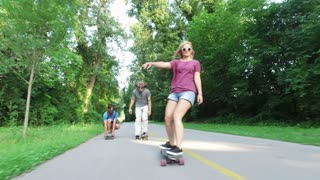 Close view of man skateboarding with friends