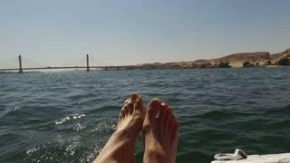 closeup of man's feet on felucca, Egypt