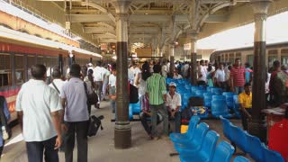 COLOMBO, SRI LANKA - FEBRUARY 2014: View of busy train station with people passing by. The Sri Lankan railway transports millions of people daily in the country.