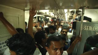COLOMBO, SRI LANKA - FEBRUARY 2014: View of crowded local people traveling in train. The Sri Lankan railway transports millions of people daily in the country.