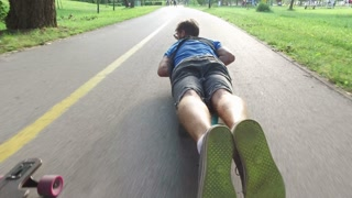 Cool guy longboarding lying down