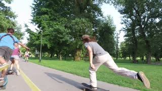 Cool young people riding skateboards and doing tricks