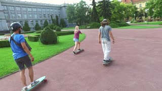 Cool young skateboarders having fun doing tricks