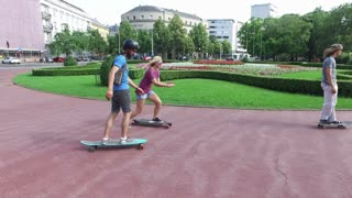Cool young skateboarders having fun in the city
