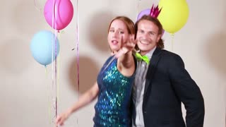 Couple dancing funny in photo booth