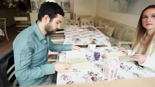 Couple in restaurant reading menu