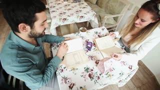 Couple in restaurant reading menus