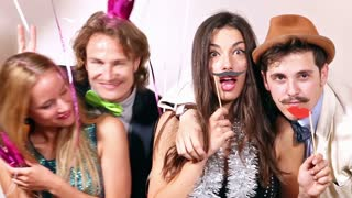 Couples enjoying in party photo booth