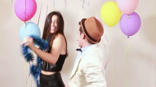 Crazy couple having great time dancing in photo booth
