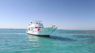Crew members anchoring the boat next to Paradise island in the Red sea
